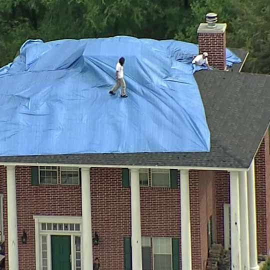 putting a tarp on a roof